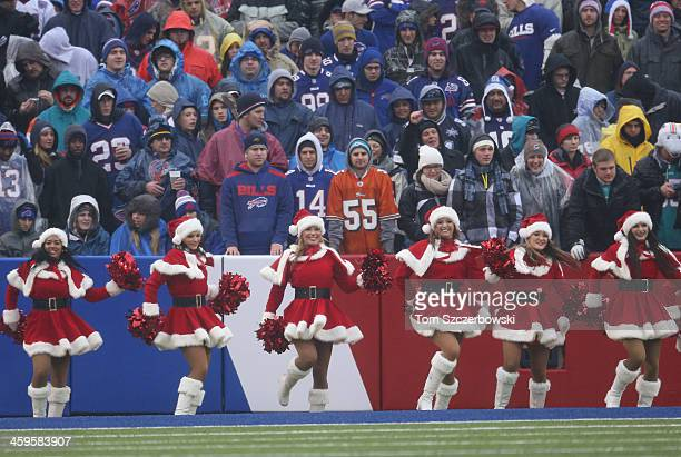 Members of the Buffalo Bills cheerleaders the Buffalo Jills perform while wearing Santa Claus outfits during NFL game action against the Miami...
