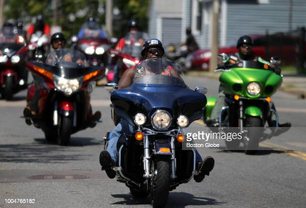 Members of the Buffalo Soldiers Motorcycle Club and others take part in a charity ride event in Boston on July 21 2018 The Buffalo Soldiers...