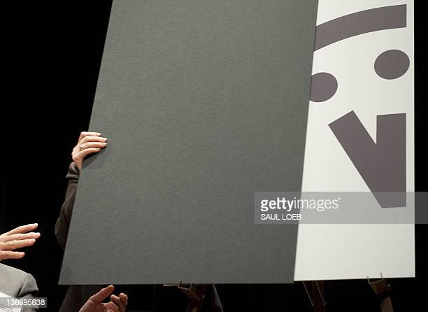 Members of the Bulletin of Atomic Scientists unveil the Doomsday Clock during an announcement that it has moved the hands to five minutes to midnight...