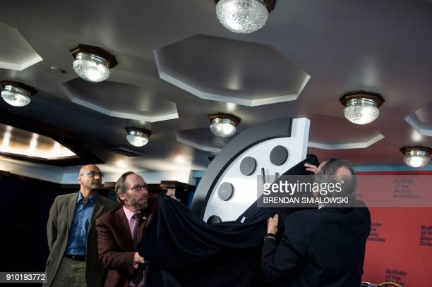 Members of the Bulletin of the Atomic Scientists unveil their Doomsday Clock which has been moved to two minutes before midnight on January 25 2018...
