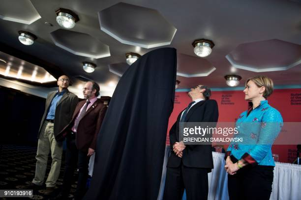 Members of the Bulletin of the Atomic Scientists wait to unveil the updated Doomsday clock time during an event on January 25 2018 in Washington DC...