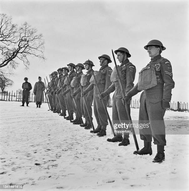 Members of the Bulmer and Belchaump Home Guard, supporting the British Army, take part in a parade and inspection with their recently issued pikes on...