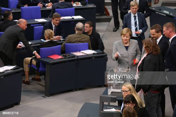 Members of the Bundestag faction of the rightwing Alternative for Germany convene as Bundestag members including German Chancellor Angela Merkel...