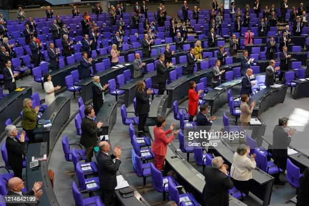 Members of the Bundestag rise to applaud medical and emergency workers on the front line of the nationwide struggle against the coronavirus prior to...