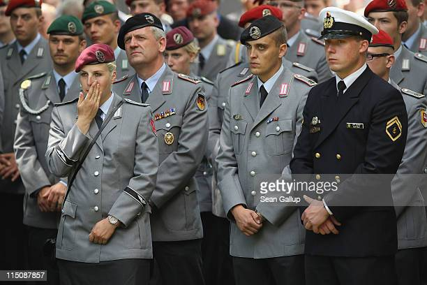 Members of the Bundeswehr the German armed forces attend commemoration services for three Bundeswehr soldiers recently killed in Afghanistan on June...