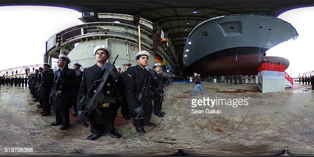 Members of the Bundeswehr the German armed forces attend the christening ceremony of the 'SachsenAnhalt' military frigate at the BlohmVoss shipyard...
