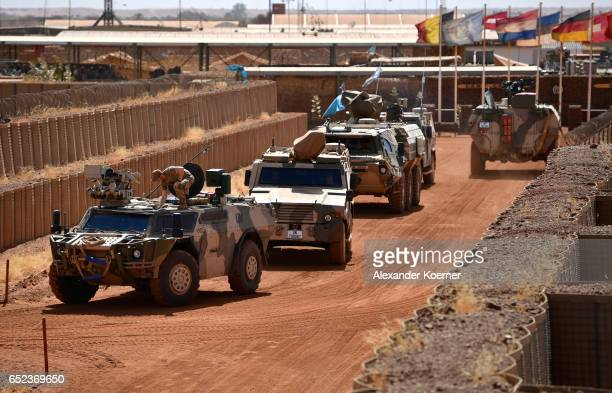 Members of the Bundeswehr the German armed forces check their vehicles at Camp Castor as part of the UNled MINUSMA enforcement mission on March 03...