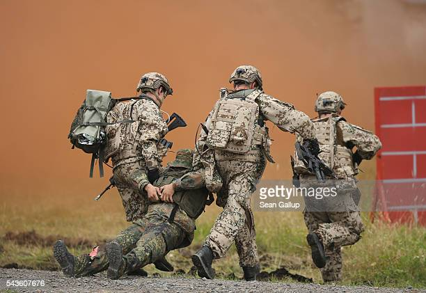 Members of the Bundeswehr the German armed forces drag a colleague pretending to be wounded during a demonstration of capabilities of...