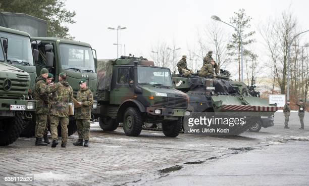 Members of the Bundeswehr the German armed forces prepare an recovery tank for loading onto a train in order to ship it and other equipment to...