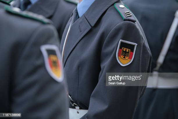 Members of the Bundeswehr the German armed forces prepare to participate in a ceremony in which new recruits took their oath of service in front of...