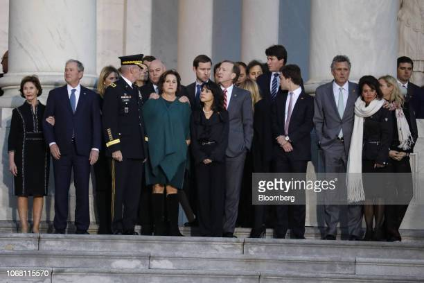 Members of the Bush family wait for the arrival of the casket of former US President George HW Bush at the US Capitol in Washington DC US on Monday...