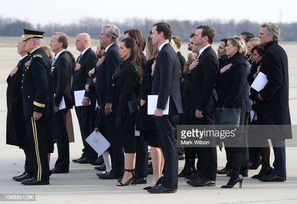Members of the Bush family watch a US Military honor guard carries casket of former US President George HW Bush before it is loaded onto a US Air...
