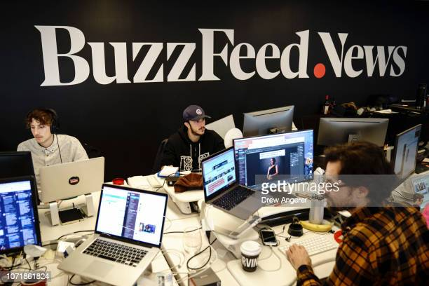 Members of the BuzzFeed News team work at their desks at BuzzFeed headquarters December 11 2018 in New York City BuzzFeed is an American internet...