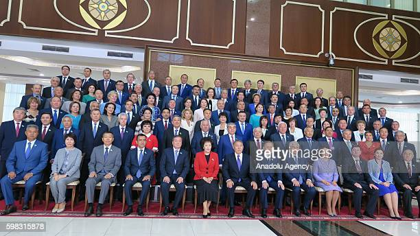 Members of the cabine pose with Kazakhstan's President Nursultan Nazarbayev after the opening ceremony of the new legislative year in Astana...