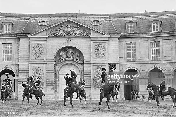 Members of the Cadre Noir of Saumur a horse training school for military and guardsmen perform at Versailles Saumur is the town where this school was...
