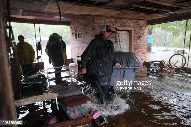 Members of the Cajun Navy search a flooded residence in Lumberton North Carolina on September 15 2018 in the wake of Hurricane Florence Besides...
