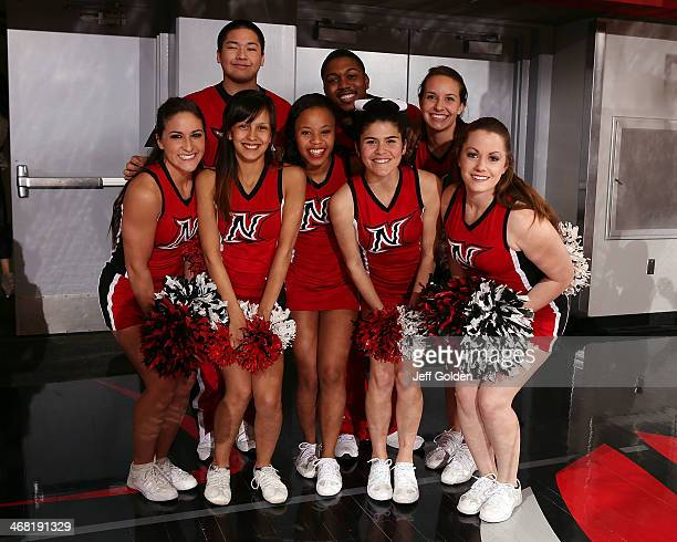 Members of the Cal State Northridge Matadors Cheer Team smile as they pose for a photo before the game against the UC Santa Barbara Gauchos at The...