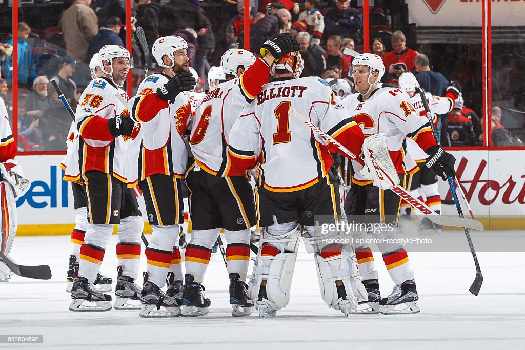 Members of the Calgary Flames celebrate their over time win against the Ottawa Senators in an NHL game at Canadian Tire Centre on January 26, 2017 in Ottawa, Ontario, Canada.