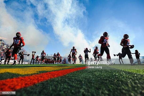 Members of the Calgary Stampeders take to the field prior to their CFL game against the Saskatchewan Roughriders at McMahon Stadium on November 17,...