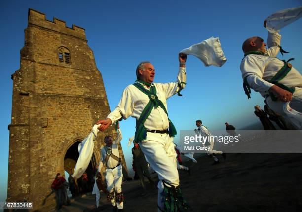 Members of the Cam Valley Morris Men dance at a May Day dawn celebration in front of St Michael's Tower on Glastonbury Tor on May 1 2013 in...