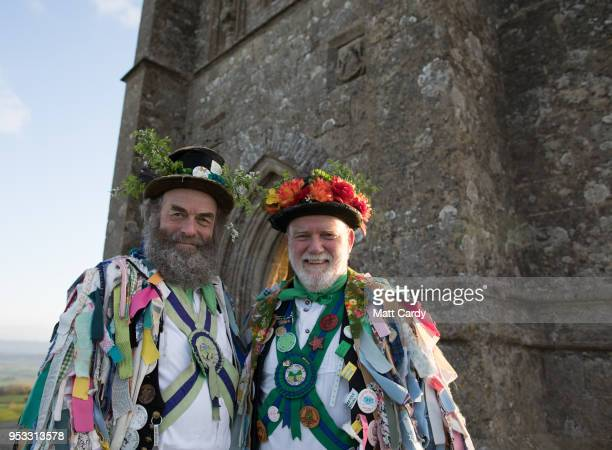Members of the Cam Valley Morris Men pose for a photograph as people gather on Glastonbury Tor to watch the sun rise as they celebrate Beltane on May...