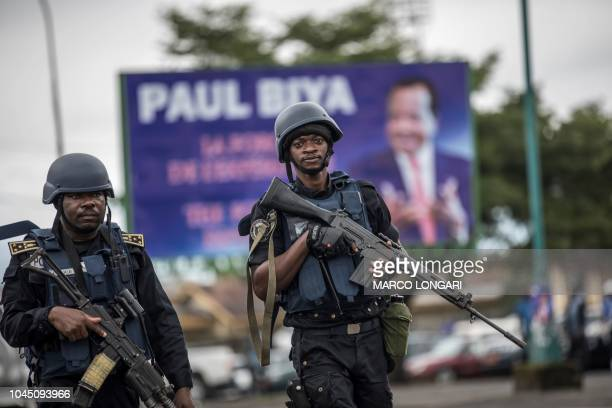 Members of the Cameroonian Gendarmerie patrols in the Omar Bongo Square of Cameroon's majority anglophone South West province capital Buea on October...