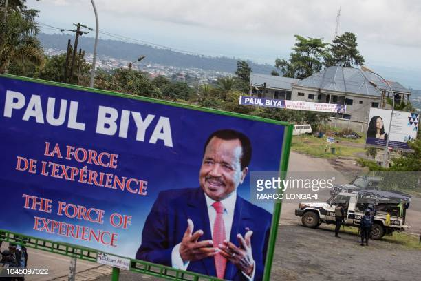 Members of the Cameroonian police patrol in the Omar Bongo Square of the majority English-speaking South West province capital Buea, on October 3,...