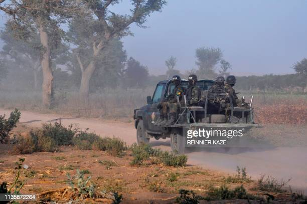 Members of the Cameroonian Rapid Intervention Force patrol on the outskirt of Mosogo in the far north region of the country where Boko Haram jihadist...