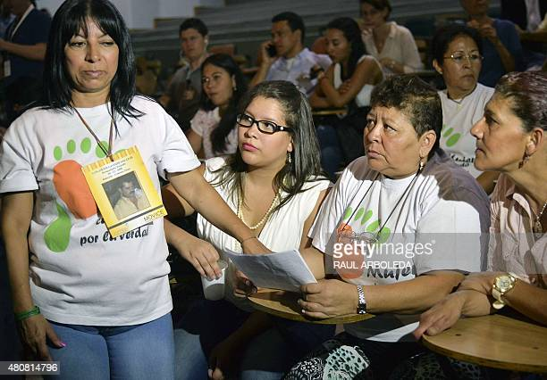 Members of the 'Caminando por la Verdad' foundation attend a press conference at the Prosecutor's office in Medellin Antioquia department Colombia on...