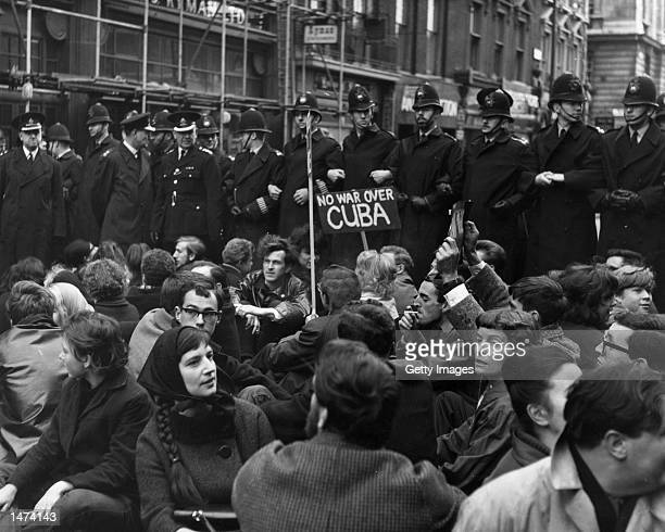 Members of the Campaign for Nuclear Disarmament stage a sit-in, protesting the Cuban missile crisis, as a line of policemen tries to prevent them...