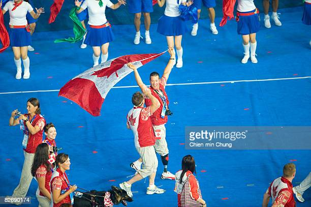 Members of the Canada team enjoy the atmosphere during entrance of Athletes in the Opening Ceremony for the 2008 Paralympic Games at the National...