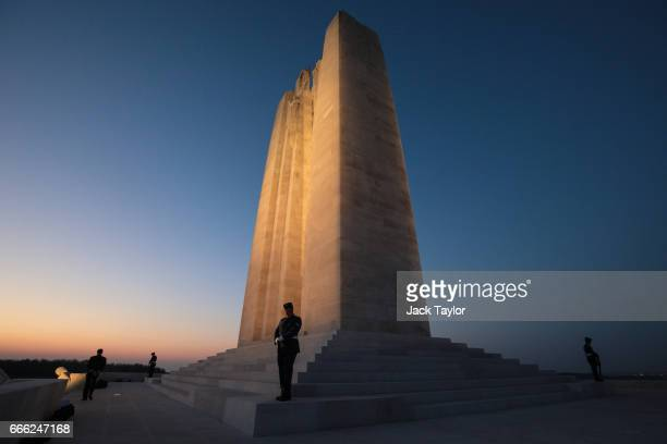 Members of the Canadian armed forces stand on the Canadian National Vimy Memorial during a nighttime vigil following a Sunset Ceremony on April 8...