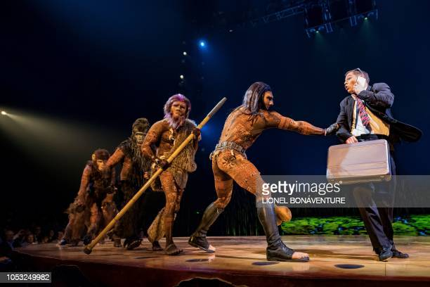 Members of the Canadian circus troop 'Le Cirque du Soleil' perform during the show Totem in Paris on October 24 2018 The show Totem will run in the...