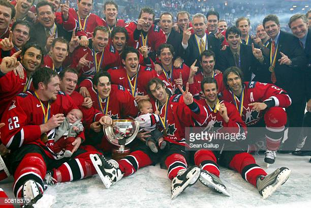 Members of the Canadian ice hockey team celebrate after winning the Finals against Sweden at the International Ice Hockey Federation World...