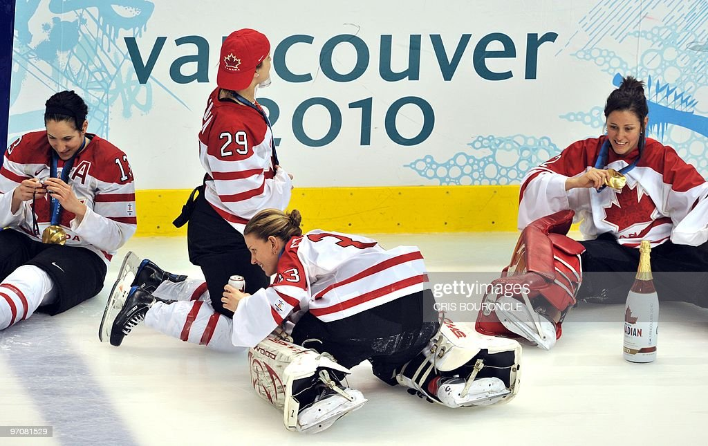 Members of the Canadian team celebrate on the ice following the medals ceremony in the Woman's Ice Hockey games at the Canada Hockey Place during the XXI Winter Olympic Games in Vancouver, Canada on February 25, 2010. Canada beat the USA 2-0 to win the gold and Finland beat Sweden 3-2 to win the bronze.
