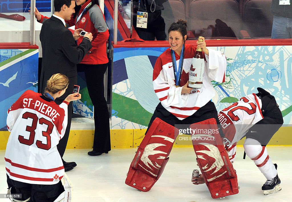 Members of the Canadian team takes pictures of each other as they celebrate on the ice following the medals ceremony in the Woman's Ice Hockey games at the Canada Hockey Place during the XXI Winter Olympic Games in Vancouver, Canada on February 25, 2010. Canada beat the USA 2-0 to win the gold and Finland beat Sweden 3-2 to win the bronze.