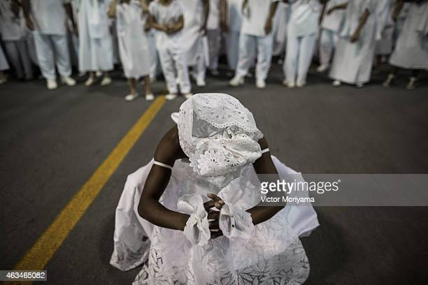 Members of the Candomble religion feature the 'Afoxe' Carnival Block opening the second day of the official carnival in Sambadrome on February 14...