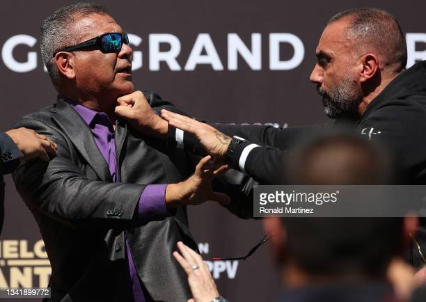 Members of the Canelo Alvarez team and Caleb Plant team shove each other during a press conference ahead of their super middleweight fight on...