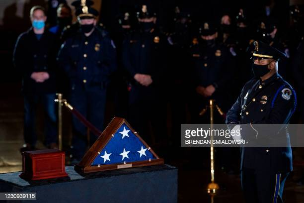 Members of the Capitol Police and others pay their respects before the remains of Capitol Police officer Brian Sicknick as he lays in honor in the...
