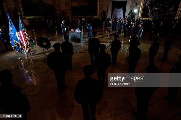 Members of the Capitol Police pay their respects to their late fellow officer Brian Sicknick who lies in honor in the Rotunda of the Capitol in...