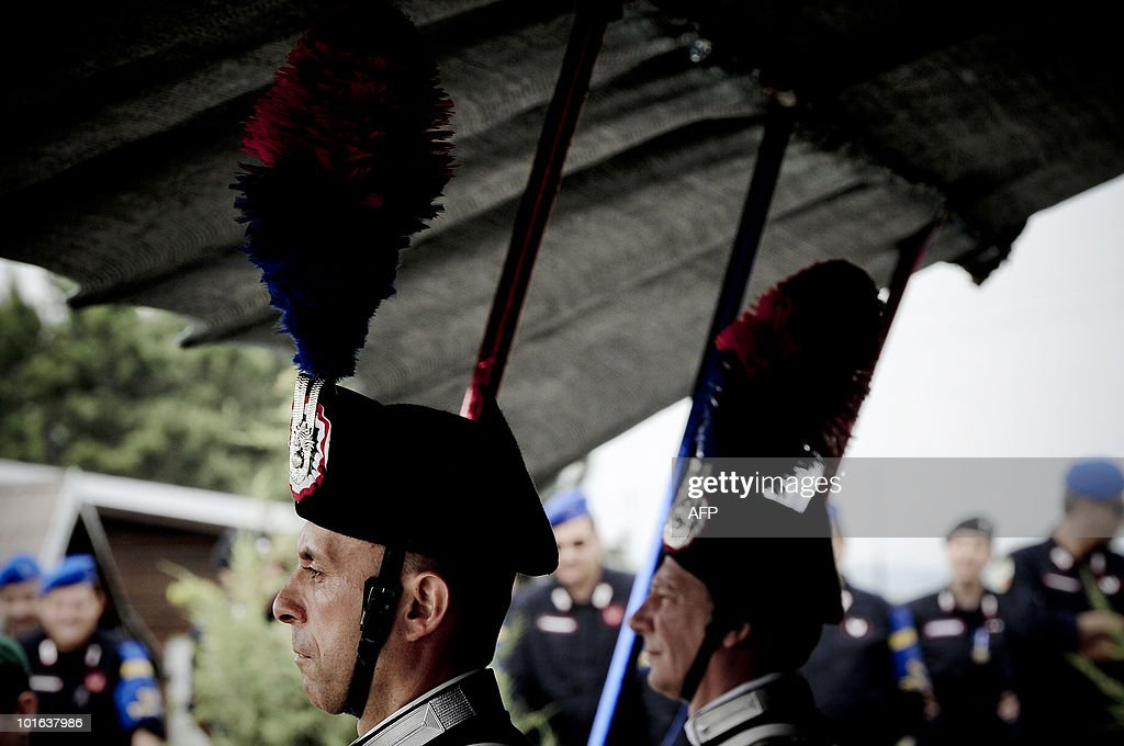 Members of the Carabinieri corps take part in a ceremony marking the celebration of the 196th anniversary of the Carabinieri in the outskirts of Pristina on June 5, 2010.