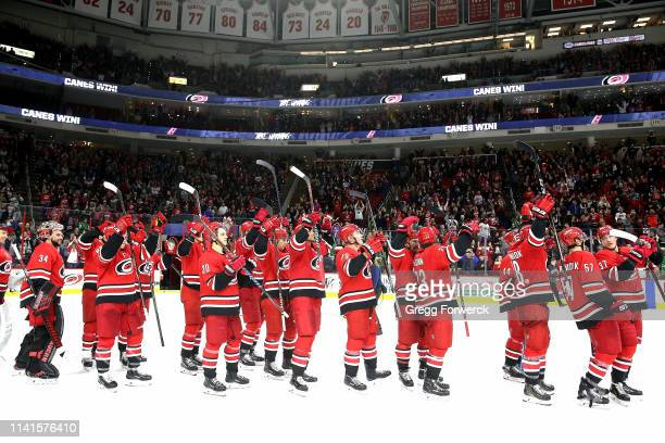 Members of the Carolina Hurricanes celebrate a victory over the Dallas Stars as they participate in a Storm Surge Celebratiion following an NHL game...