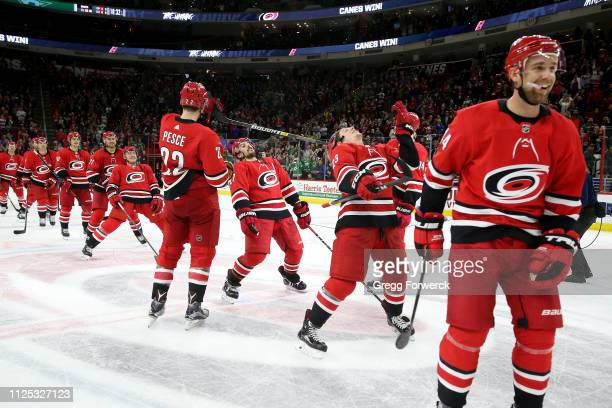 Members of the Carolina Hurricanes perform a limbo during the Storm Surge following a victory over the Dallas Stars during an NHL game on February 16...