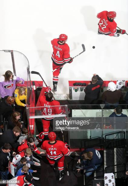 Members of the Carolina Hurricanes take to the ice for warmups prior to an NHL game against the Detroit Red Wings on February 2 2018 at PNC Arena in...