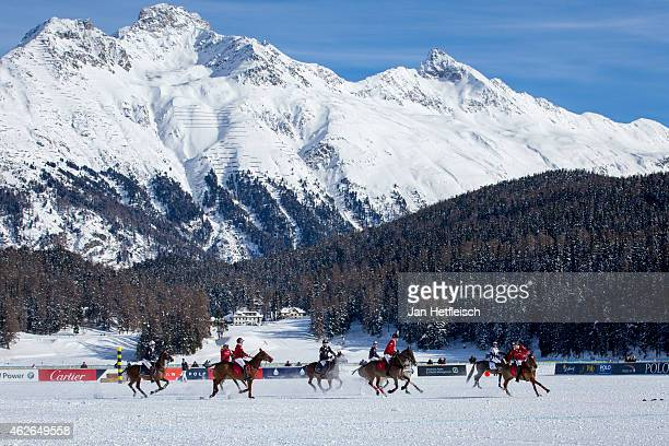 Members of the 'Cartier' team battle for the ball with team 'Badrutts Palace Hotel' during the Snow Polo World Cup 2015 on January 31 2015 in St...