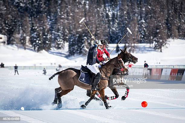 A members of the 'Cartier' team battles for the ball with team 'Badrutts Palace Hotel' during the Snow Polo World Cup 2015 on January 31 2015 in St...