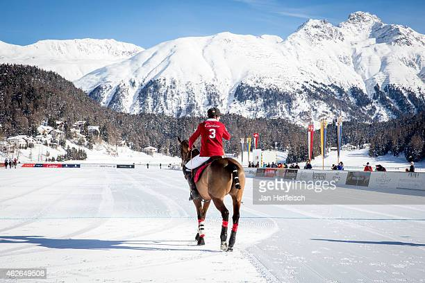 A members of the 'Cartier' team rides on the pitch during the Snow Polo World Cup 2015 on January 31 2015 in St Moritz Switzerland