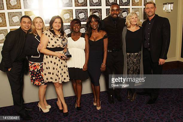 Members of the cast and crew including Jo Joyner Ricky Norwood Nina Wadia and Diane Parish of Eastenders pose in front of the winners boards at the...