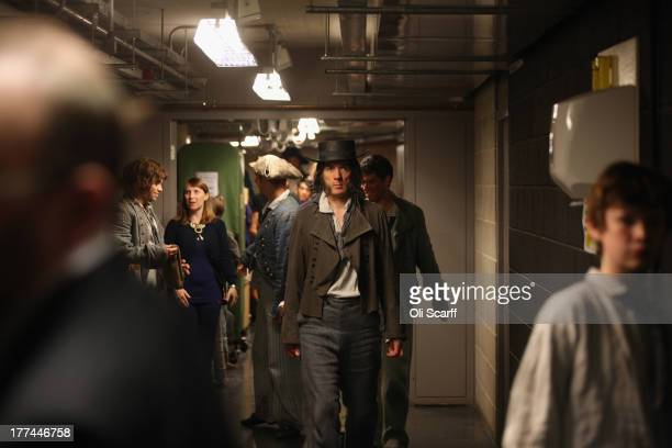 Members of the cast at Glyndebourne opera house prepare to retake the stage at the end of the long interval during a production of the Benjamin...