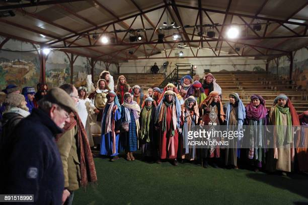 Members of the cast clasp hands as they pray ahead of the dress rehearsal of The Wintershall Nativity the annual nativity play performed in a barn on...